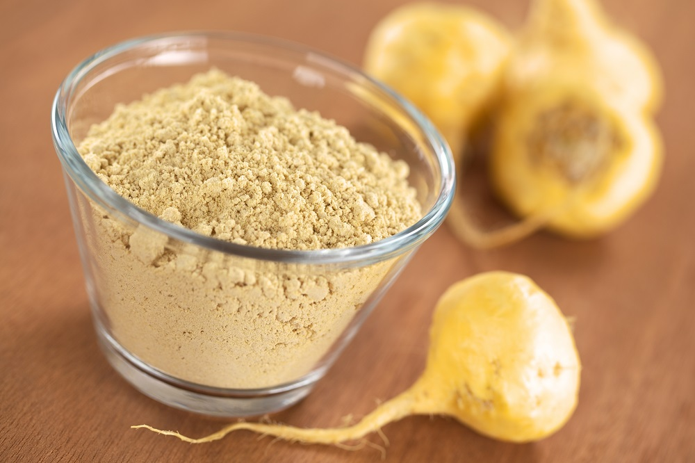 Maca-powder-flour-in-glass-bowl-with-maca-roots-or-Peruvian-ginseng-lat_-Lepidium-meyenii